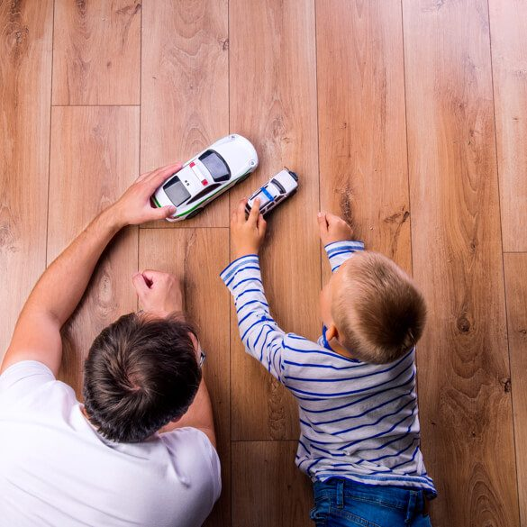 Kid and dog playing with toy car | Carpets by Direct