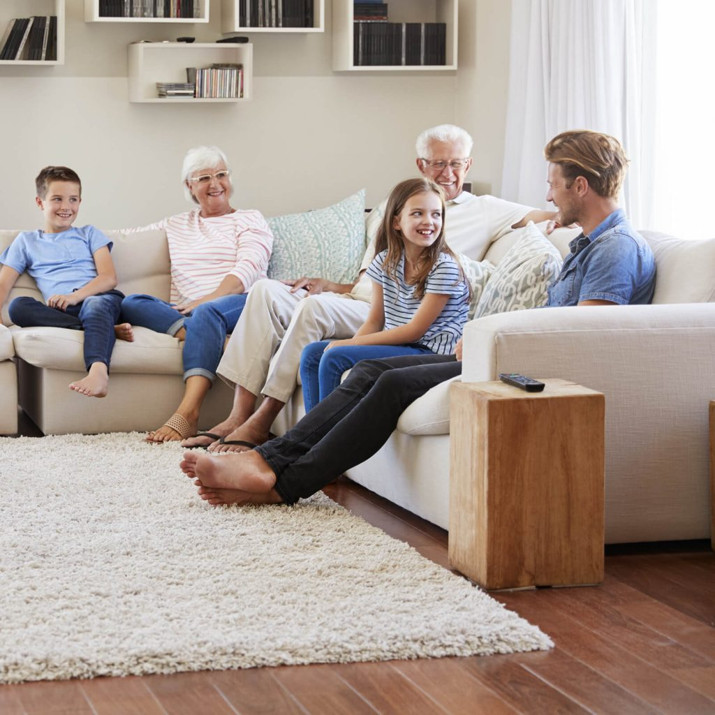Family enjoying in living room | Carpets by Direct