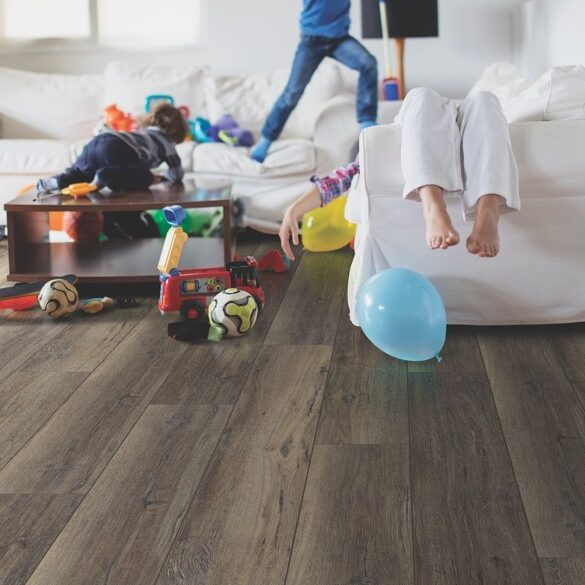 Kids playing on luxury vinyl tile flooring | Carpets by Direct